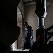 A monk walks down the grand granite stairs to reach the library. Solesmes on 17-10-2019<br /> Un moine emprunte le grand escalier en granit pour se rendre à la bibliothèque. Solesmes le 17-10-2019