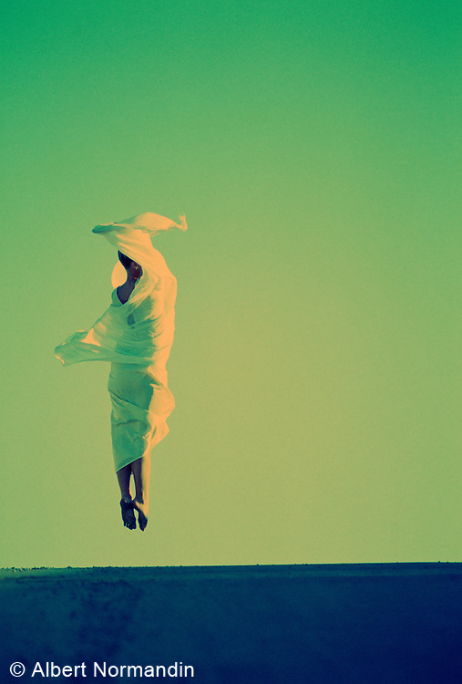 Dancer jumping up wrapped in cloth