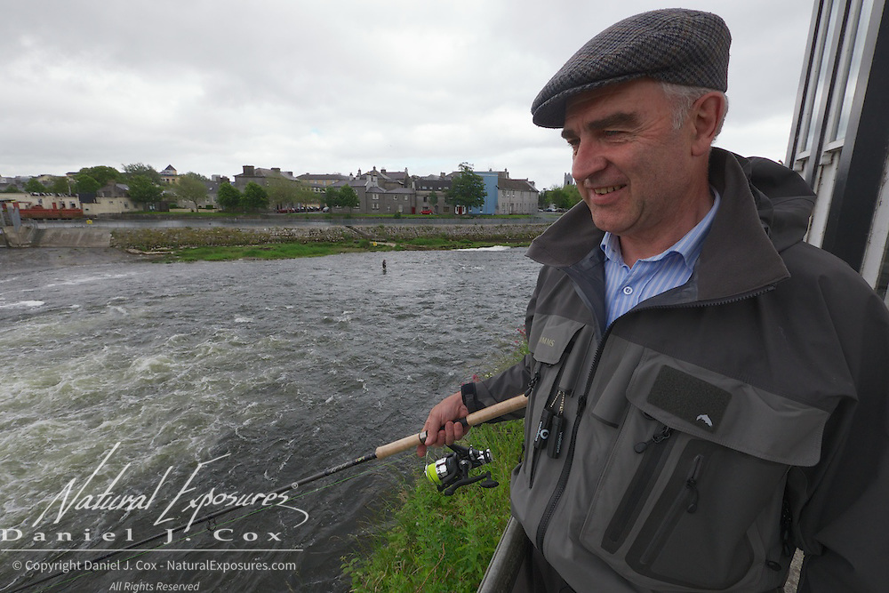 Brian King fishes the Corrib river for salmon, Galway, Ireland.