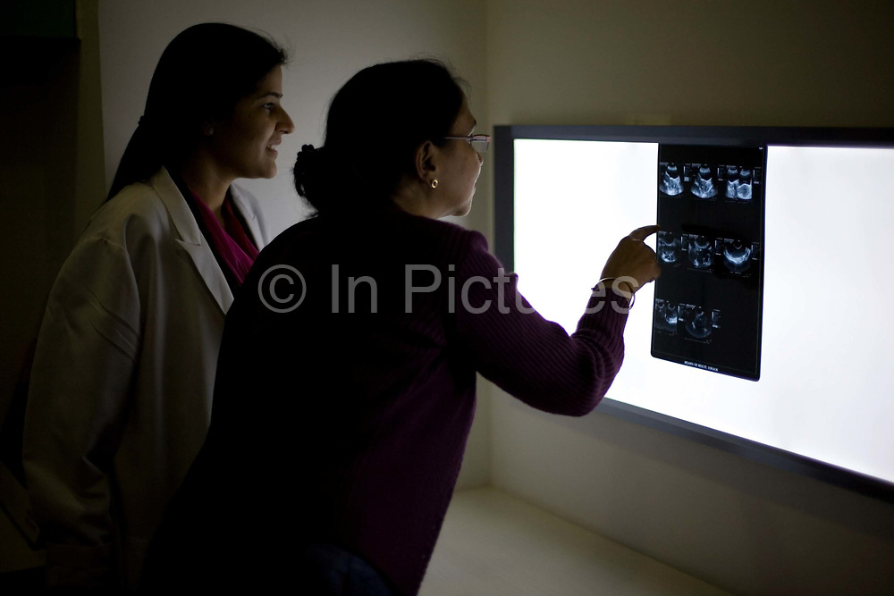 Two doctors examine a patient's x-ray in the Medicity Hospital<br /> <br /> The Medicity, Gurgaon is India's most technologically advanced multi disciplinary hospital. Founded by India's leading cardiac surgeon, Dr Naresh Trehan, it will when completed also contain a medical school and 1600 beds with over 48 operating theatres.