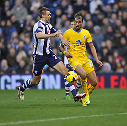 Crystal Palace's Marouane Chamakh sends a ball across the box under pressure from  West Bromwich Albion's Gareth McAuleyPhoto mandatory by-line: Alex James/JMP - Tel: Mobile: 07966 386802 02/11/2013 - SPORT - FOOTBALL - The Hawthorns - West Bromwich - West Bromwich Albion v Crystal Palace - Barclays Premier League
