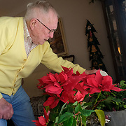 Ken Snyder waters flowers at his Dorian Drive home in Maumee, Ohio, on Saturday, Feb. 22, 2020. Brothers George Snyder, Jr., 97, and Ken Snyder, 96, both served in World War II. THE BLADE/KURT STEISS <br /> MAG WWIIVet01