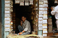 Spice merchant on the phone in  the old market in Indra Chawk Square  of Kathmandu, Nepal.
