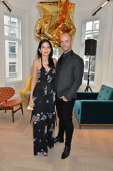 YASMIN MILLS and JUSTIN HORNE at a party to celebrate the launch of the new Stephen Webster Salon at 130 Mount Street, London on 18th May 2016.