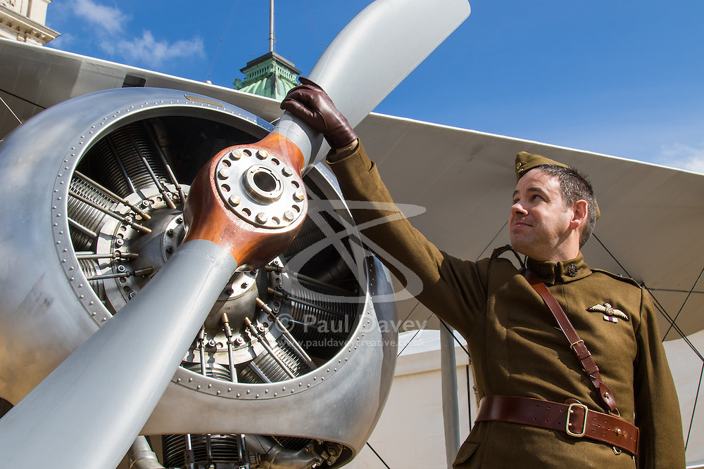 Horseguards Parade, Westminster, March 31st 2016. Dressed in period Royal Flying Corps uniform, Education Officer Vernon Creek of the Royal Air Force Museum poses with a 1918 Sopwith Snipe. The Royal Air Force Museum displays three aircraft on Westminster's Horseguard's Parade to promote the forthcoming 100th anniversary of the establishment of the Royal Air Force. The aircraft are a 1918 Sopwith Snipe, a Second World War Spitfire Mk XVI and a modern Eurofighter Typhoon. <br /> ©Paul Davey<br /> FOR LICENCING CONTACT: Paul Davey +44 (0) 7966 016 296 paul@pauldaveycreative.co.uk