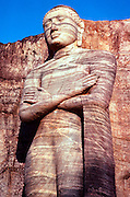 SRI LANKA, BUDDHISM The Gal Vihara Buddha, standing figure 23  feet tall, cut from solid rock, carved in  the 12th.C at Polonnaruwa
