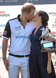 7 in series of 10. File photo dated 26/7/2018 of Prince Harry and Meghan Markle having a kiss at the Sentebale ISPS Handa Polo Cup at the Royal County of Berkshire Polo Club in Windsor.