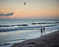 Tern and the Fishermen. Dawn at Playalinda Beach in Canaveral National Seashore. Merritt Island, Florida. Image taken with a Nikon N1V2 camera and 18.5 mm f/1.8 lens (ISO 500, 18.5 mm, f/4, 1/1000 sec).