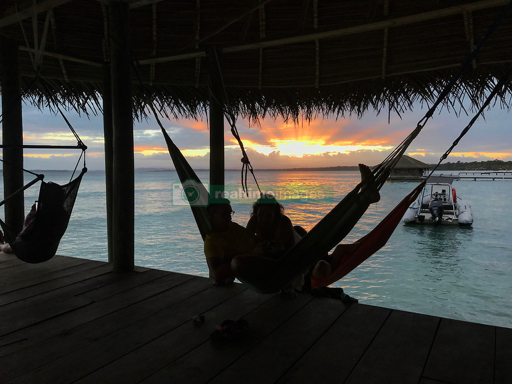 EXCLUSIVE: How about owning your own tropical Caribbean luxury resort for just $10. American couple Suzanne and Dave Smith are selling off their incredible Casa Cayuco Eco Adventure Lodge, in Bocas del Toro, Panama, Central America. But instead of listing their stunning multi-million-pound island getaway for sale they are offering the chance for anyone who buys a $10 ticket to win their extraordinary lifestyle and profitable business. Dave and Suzanne have spent five years turning a former rustic lodge into one that has just been voted number one resort on TripAdvisor in Panama. Their incredible two-acre slice of heaven is bordered by sloth-filled rainforest to the rear and crystal clear coral sea to the front. The lucky winner of the 24-guest resort will become owner of four stand-alone cabins, a main lodge, two lodge suites, and an air-conditioned luxury owner's suite designed by Dave and Suzanne themselves and built by skilled local carpenters. Outside, Casa Cayuco comes with its own jetty and thatch covered sun terrace as well as everything you need to run a business, including commercial kitchen communication tower, laundry and maintenance building and THREE power boats, each over 23-foot long. Kayaks, snorkelling, spear fishing and paddle boards and surf gear are also ready and waiting to be used by a new owner and guests alike. And if that's not enough, British competition organisers WinThis.Life https://winthis.life/index.aspx# are offering a $50,000 cash injection to welcome the new owners. All those wishing to take part have to do is buy one or more tickets and play a spot-the-ball-type competition on the website. Entries are being taken extension until April 11. Dave, 35, and Suzanne, 33, first arrived on the island in 2013 with just seven suitcases having decided to sell up from their home and corporate lives near Detroit, Michigan, USA. 16 Feb 2018 Pictured: Pic shows guests relaxing at the stunning Caribbean resort Casa Cayuco in Panama which one l