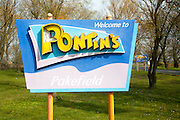 Sign for Pontin's holiday camp at Pakefield, near Lowestoft, Suffolk, England some vandalism damage to lettering
