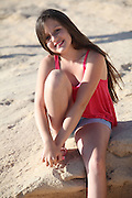 smiling young girl of 12 on the beach Model Release Available