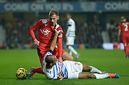 Marc Albrighton of Leicester City tussles with Karl Henry of Queens Park Rangers. Barclays Premier league match, Queens Park Rangers v Leicester city at Loftus Road in London on Saturday 29th November 2014.<br /> pic by John Patrick Fletcher, Andrew Orchard sports photography.