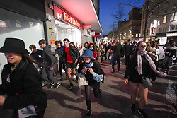 © Licensed to London News Pictures. 17/04/2021. Liverpool, UK. Revellers are seen running away as police try to disperse the crowd during the first weekend in Liverpool city centre after lockdown restrictions were eased Photo credit:  Ioannis Alexopoulos/LNP