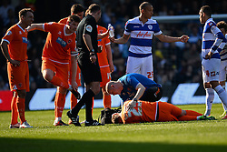 Blackpool's midfielder James Caton gets treatment for an injury - Photo mandatory by-line: Mitchell Gunn/JMP - Tel: Mobile: 07966 386802 29/03/2014 - SPORT - FOOTBALL - Loftus Road - London - Queens Park Rangers v Blackpool - Championship