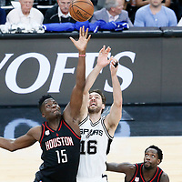03 May 2017: Jump ball between Houston Rockets center Clint Capela (15) and San Antonio Spurs center Pau Gasol (16) during the San Antonio Spurs 121-96 victory over the Houston Rockets, in game 2 of the Western Conference Semi Finals, at the AT&T Center, San Antonio, Texas, USA.