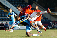 Photo: Kevin Poolman.<br />Wycombe Wanderers v Walsall. Coca Cola League 2. 17/03/2007. Anthony Grant of Wycombe is taken out by Daniel Fox of Walsall.