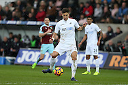 Federico Fernandez of Swansea city in action .Premier league match, Swansea city v Burnley at the Liberty Stadium in Swansea, South Wales on Saturday 4th March 2017.<br /> pic by Andrew Orchard, Andrew Orchard sports photography.