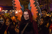 New York, NY - 31 October 2015. A woman in orange and black butterfly wings in the annual Greenwich Village Halloween Parade.