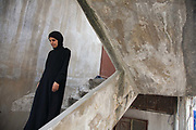 Delal walks down the steps to her temporary home in Shatila. She is a Palestinian from Damascus and now lives as a refugee in Shatila, a Palestinain camp in Beirut. She lives in Shatila with her extended family after they had to flee the war in Syria.