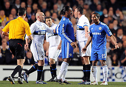 16-03-2010 VOETBAL: CHELSEA FC  - INTER MILAAN : LONDON<br /> Didier Drogba clashes with Inter Milan s Lucio<br /> ©2010- nph /  Chris Brunskill