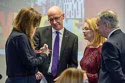 Pictured:  Fiona Drouet shows the new card that provides information on how the deal with and report gender based abuse to John Swinney, Cabinet secretary Shirley-Anne Somerville and Minister for Further Education Richard Lockhead Richa<br /> <br /> Education Secretary John Swinney  joined college and university staff to launch a resource to handle gender-based violence. Fiona Drouet's daughter Emily committed suicide following being abused by a fellow student.  She started the Emily test and gathered political support for the establishment of a resource so that all students and staff who how to repond if they or others are abused due to gender.  More than 100,000 cards have been printed featuring the national support helplines for gender-based violence and sexual harassment. They have been designed to be carried constantly by staff, to enable them to quickly refer any victims to help.