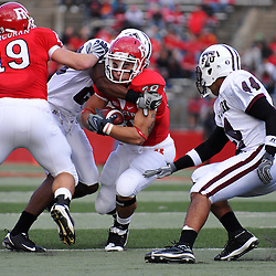 Oct 10, 2009; Piscataway, NJ, USA; Rutgers running back Joe Martinek (38) is wrapped up by a defender during first half NCAA college football action between Rutgers and Texas Southern at Rutgers Stadium.