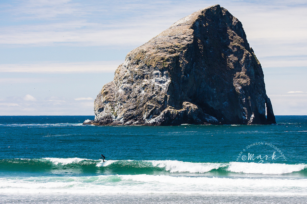 Stand Up Paddle Surfing at Pacific City, Chief Kiawanda Rock in background, Oregon, USA