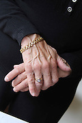 Antique Gold  jewelry from Libya on the hands of a mature woman.