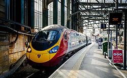 A Virgin express passenger train arriving at Glasgow Central Station from London Euston<br /> <br /> (c) Andrew Wilson | Edinburgh Elite media