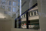The interior of a vacant office with reflections of nearby architecture and Pudding Lane, the location where the Great Fire of London started in 1666, in the City of London.