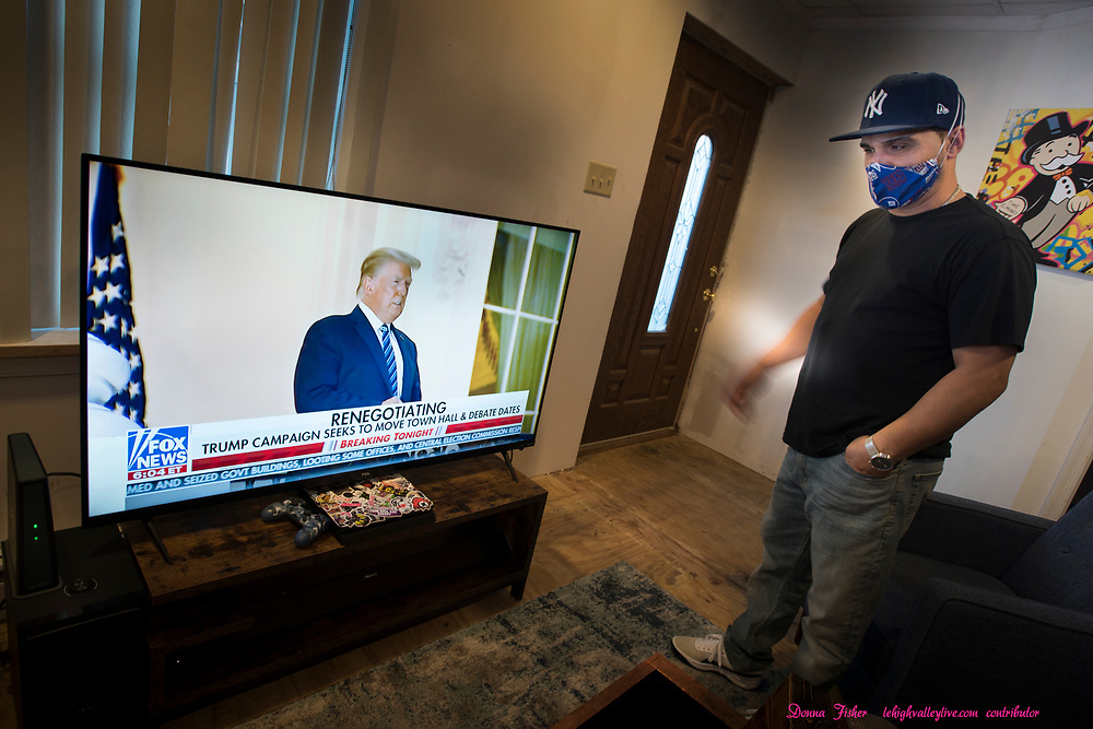 Campaign 2020 - voter profiles - Juan Rodriguez watches Fox News at his home in Nazareth, Pa. on October 8, 2020.