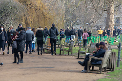© Licensed to London News Pictures. 23/01/2021. London, UK. Members of the public enjoy a walk in the winter sunshine in St James's Park, London today. Yesterday, Prime Minister Boris Johnson revealed that the new UK Covid-19 mutation B.1.1.7 could be 30 per cent more deadly than the previous ones as senior NHS doctors want the gap between doses halved to six weeks rather than the current 12 weeks. Photo credit: Alex Lentati/LNP