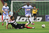 Football - Shaun Wright-Phillips of QPR avoids a sliding tackle during the friendly match against Kelantan Select XI during the QPR Asian Tour 2012 at the Shah Alam Stadium, Selangor, Malaysia