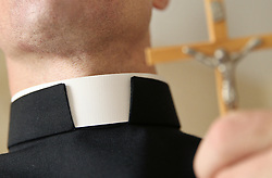 October 20, 2018 - Krosno, Poland - Each year, we hear about various scandals involving the clergy of the Catholic Church. Fraud, pedophilia, alcoholism are just some of them. On the picture: A priest wears a clerical collar, cross (Credit Image: © Damian Klamka via ZUMA Wire)