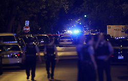 September 10, 2017 - Chicago, IL, USA - The 2000-2200 block of North Laramie Avenue is blocked off as a crime scene early Sunday, Sept. 10, 2017, in Chicago. A police officer fatally shot a 19-year-old man  who pinned the officer with his car after being pulled over for erratic driving, in the 2100 block of North Laramie Avenue, according to police. The officer was transported to a nearby hospital in serious condition..(John J. Kim/Chicago Tribune/TNS) (Credit Image: © John J. Kim/TNS via ZUMA Wire)