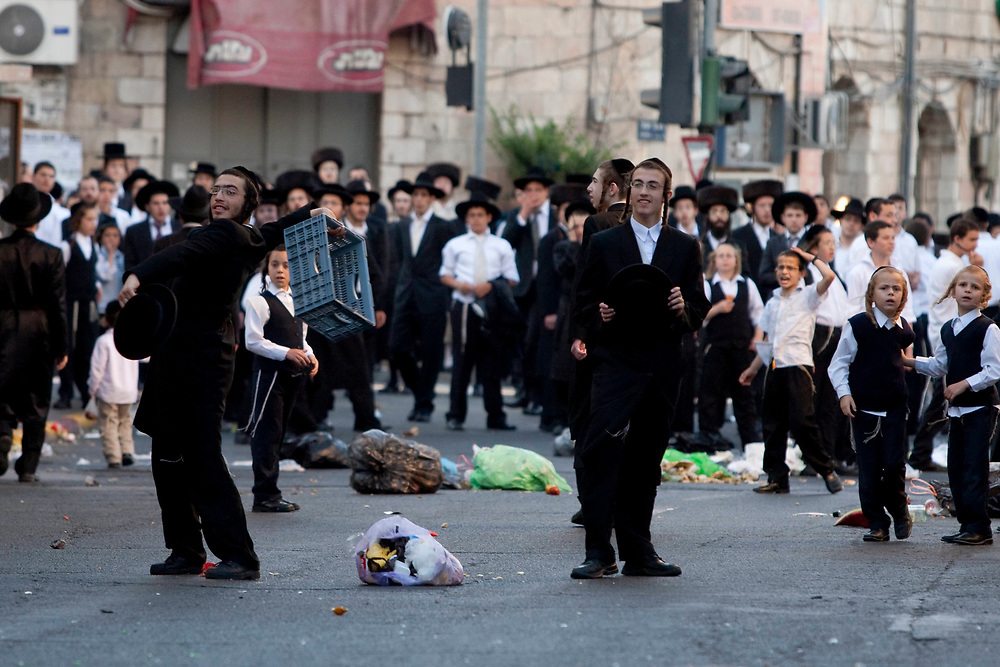 Ultra-Orthodox Jewish men and children attend a demonstration against the opening of a municipal parking lot on the Jewish Sabbath, in Jerusalem, Israel, on June 27, 2009.