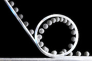 .This is a demonstration of a ball rolling down an incline and almost making the loop-the-loop path.  The ball does not have enough velocity to make the loop.  The velocity required to make the loop is called the critical velocity, and this show a situation where the ball leaves the surface of the track, or the normal force from the track on the ball is zero.  The analysis of this demo requires the use of the centripetal force, kinetic energy, potential energy, rolling energy, and friction.  This is also an example of a sub critical velocity.  The loop is 19.5 cm in diameter and the ball is 2.5 cm in diameter. The flash illuminates the scene at 40 hz showing images every  .025 seconds of time. .