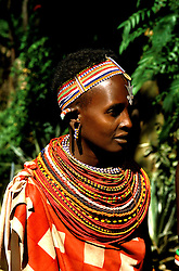 Kenya East Africa, tribeswoman, Masai villager at Samburu, tribal necklace, bead jewelry    .Photo copyright: Lee Foster, www.fostertravel.com, photo kenyas105, 510-549-2202, lee@fostertravel.com