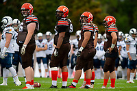KELOWNA, BC - SEPTEMBER 8:  Daniel Townsend #66, Karn Sidhu #95, Danil Balan #58 and Liam Hamlyn #50 stand on the field against the Langley Rams  at the Apple Bowl on September 8, 2019 in Kelowna, Canada. (Photo by Marissa Baecker/Shoot the Breeze)