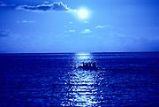 Outrigger Canoe in moonlight, Hawaii<br />