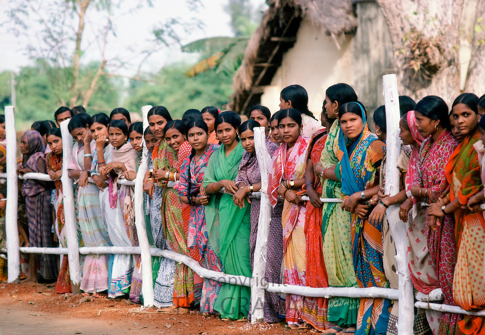 Group of Indian women wearing traditional saree and watching festivities