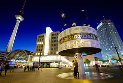 Night view of World Clock at Alexanderplatz in Mitte Berlin Germany