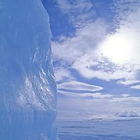 BAFFIN ISLAND, Nunavut, Canada. Iceberg locked into ice on frozen Baffin Bay.