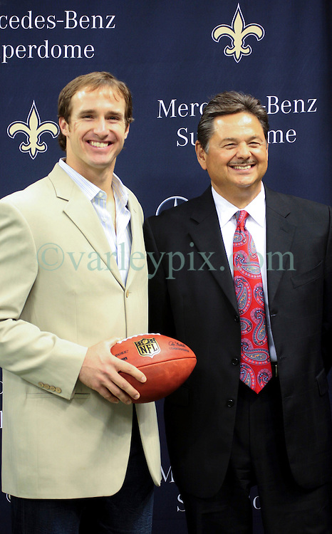 04 October 2011. New Orleans, Louisiana, USA.  <br /> NFL's New Orleans Saints announce a multi million dollar deal with Mercedes-Benz for naming rights on the Louisiana Superdome. Now the Mercedes-Benz Superdome. Saints quarterback Drew Brees and Mercedes-Benz USA President and CEO Ernst Leib.<br /> Photos; Charlie Varley/varleypix.com