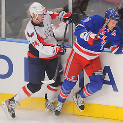April 30, 2012: Washington Capitals defenseman John Carlson (74) checks New York Rangers defenseman Marc Staal (18) during first period action in Game 2 of the NHL Eastern Conference Semifinals between the Washington Capitals and New York Rangers at Madison Square Garden in New York, N.Y.
