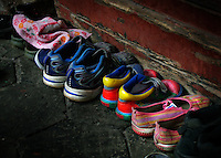 The orphans have gone inside and left their shoes behind.