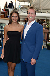 The Johnnie Walker Blue Label and David Gandy Drinks Reception aboard John Walker & Sons Voyager, St.Georges Stairs Tier, Butler's Wharf Pier, London, UK on 16th July 2013.<br /> Picture Shows:-Henry Beckwith and Jo Renwick.