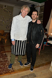 Left to right, MATTHEW HORTON and KINDER AGGUGINI at the opening party for the KPH Pub at 139 Ladbroke Grove,London on 29th January 2014.