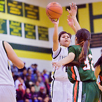 022713       Cable Hoover<br /> <br /> Thoreau Hawk Alyssa Yazzie (10) shoots over the Wingate Bears defense Wednesday at Gallup High School.