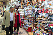 Muslim couple shopping in The Grand Bazaar, Kapalicarsi, great market in Beyazi, Istanbul, Republic of Turkey